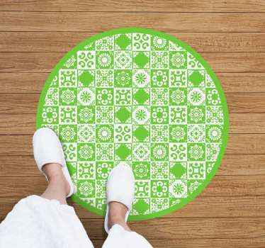 An abstract vinyl rug in green and white to decorate any space you want. High quality and very resistant product delivered to your house.