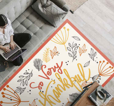 Colorful vinyl rug for home decoration. Lovely carpet printed with ornamental flowers and text that reads 'So very thankful''.