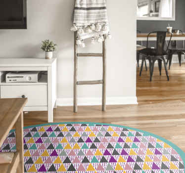 A colorful scandinavian triangles vinyl rug to make everybody that enters your house be amazed by it. Very colorful product in a round shape.