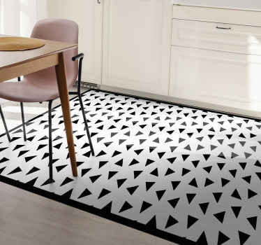 Geometric triangle vinyl rug which features a patterns of black triangles on a white background. Available in 50 colours.