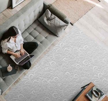 Tappeto in vinile grigio che presenta uno splendido motivo di volute che sembrano 3d. Il motivo è colorato in una brillante tonalità di grigio.