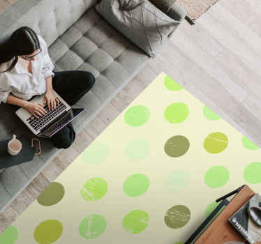 Polka dot vinyl rug which features an awesome pattern of polka dots in various shades of light and dark green. Anti-bubble vinyl.