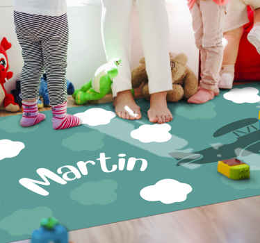 Personalised vinyl rug which  features an amazing image of an old fashioned plane flying through a clouded sky with your child's name in the middle.