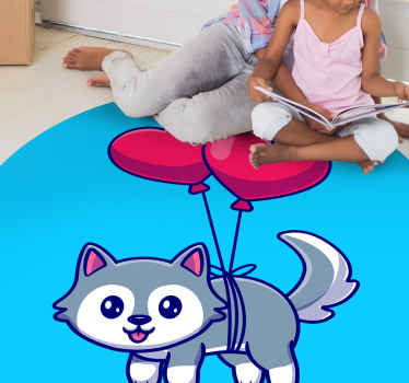 Circular vinyl rug with blue background and the illustration of a cute animal attached to two red balloons that will fill with tenderness the space.