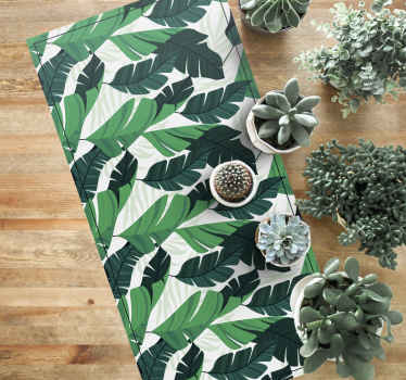Nature vinyl rug with natural style and illustration of banana leaves in various shades of green, ideal for you to decorate your home.