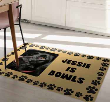 Get this amazingly cute dog in your kitchen as a kitchen mat. It shows a picture of a black dog with a personalized text next to it. Order now!