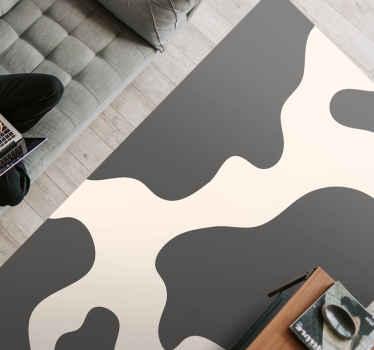 Alfombra vinilo animal print con estampado de vaca para decorar tu casa de forma original. Puedes elegir medidas y es fácil de mantener.