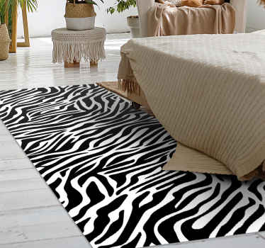 This classic design of an animal vinyl rug looks like a Zebra with classic white and black thin stripes. Anti-slip material. Available in many sizes!
