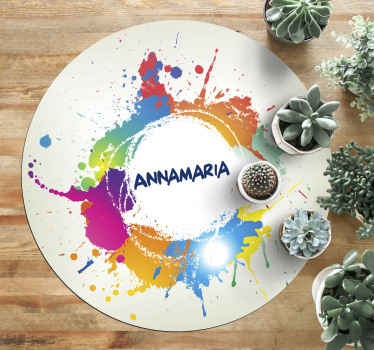 This particular design of a personalised vinyl rug is a circular white shape with a chosen name in the middle, surrounded by a splash of colours!