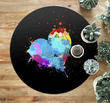 Take a look at this lovely modern vinyl rug with splash of colours shaped as a heart on a black background. Circular shape will add style to any room!