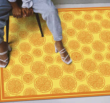 This kitchen vinyl rug has slices of orange in a hand drawn design all over it, on a bright yellow background with an orange frame. Must buy!