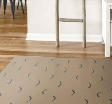 Dit moderne vinyl vloerkleed is gebaseerd op een beige achtergrond die lijkt op zand met kleine golvende vormen erop. Bestel hem vandaag nog!