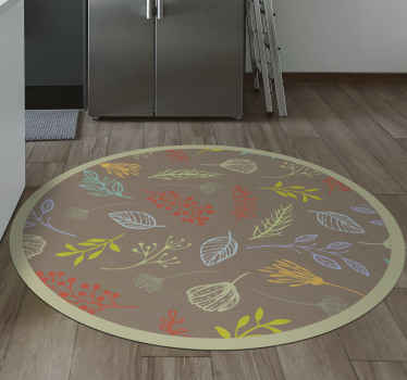 This circular vinyl rug is based on a light brown background with pastel colour flower silhouettes all over it. Home delivery!