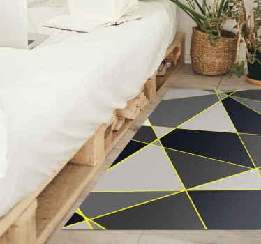 La moderna alfombra vinilo nórdica se basa en unas formas geométricas en gris y negro con contorno amarillo ¡Envío exprés a domicilio!