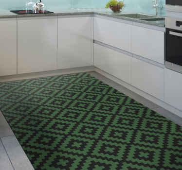Ce tapis en sticker effet carreaux est plein de carrés vert foncé et noirs dans un sticker répété avec un effet zig zag unique.
