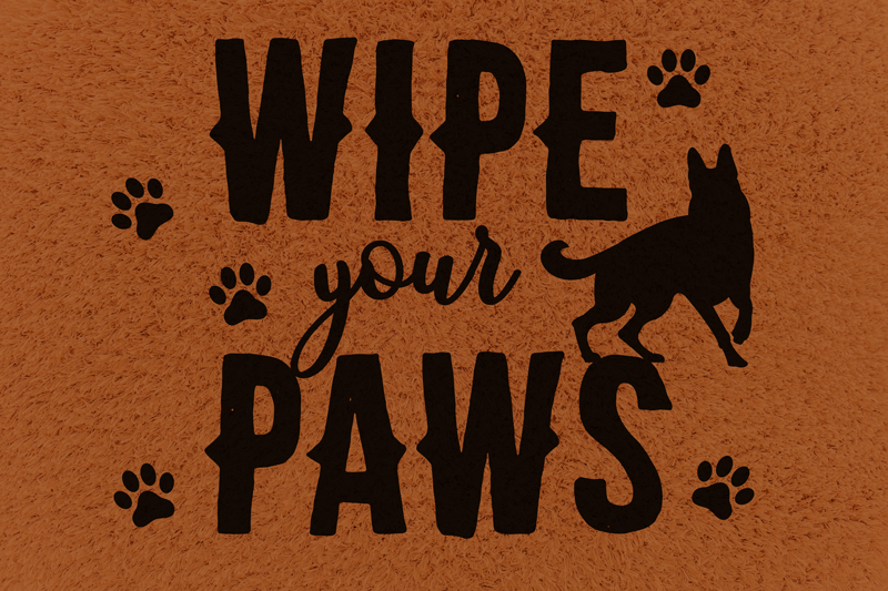 """TenStickers. Wipe your paws animal vinyl rug. This entrance vinyl rug with a brown background and black text that says """"Wipe your paws"""" with a dog and paw prints around the text is a must have!"""