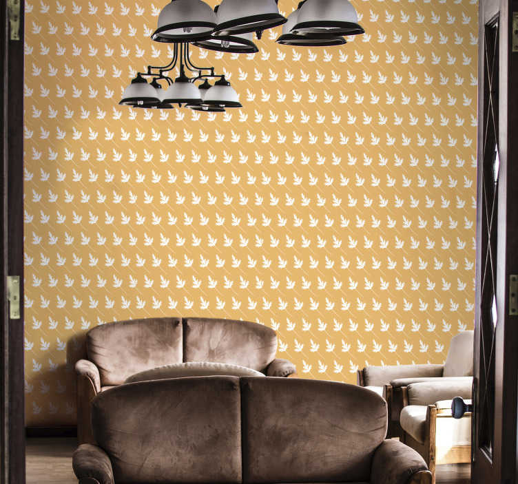 TenVinilo. Papel pared patrón de hojas pequeñas. Compre este papel pintado amarillo con el patrón de pequeñas hojas blancas para decorar su sala de estar de una manera moderna ¡Envío a domicilio!