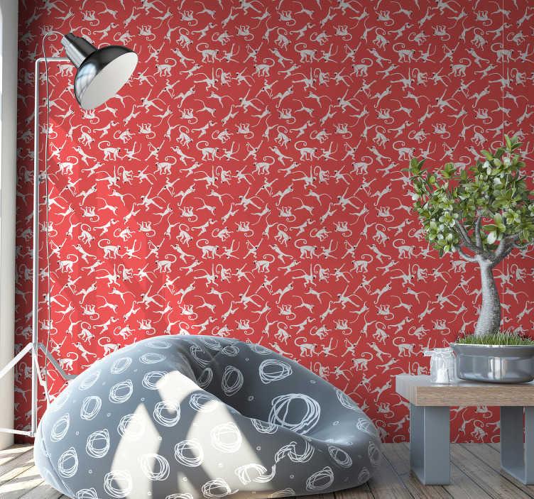 TenStickers. Papel de parede de natureza selva com macacos. Redecore sua sala de estar ou quarto com este papel de parede de animais cheio de macacos fofos pulando no fundo vermelho. Alta qualidade!