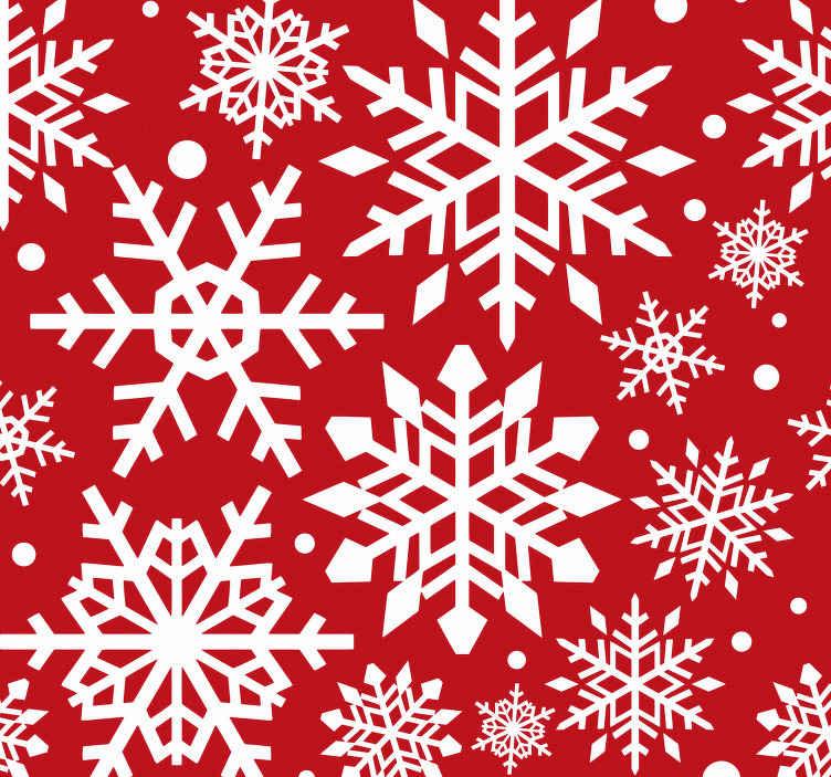 TenVinilo. Papel pintado para salón copos nieve rojos. Traiga la caída de la nieve navideña a su casa con nuestro papel pintado rojo de copos de nieve perfecto para decorar ¡Envío a domicilio!