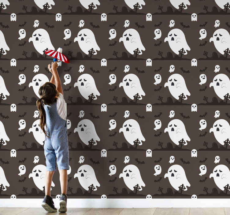 TenStickers. Cute little Ghost Halloween Wallpaper. Ghost wallpaper featuring  lots of small adorable ghosts in a graveyard surrounded by a few bats. Sign up for 10% off. High quality material.