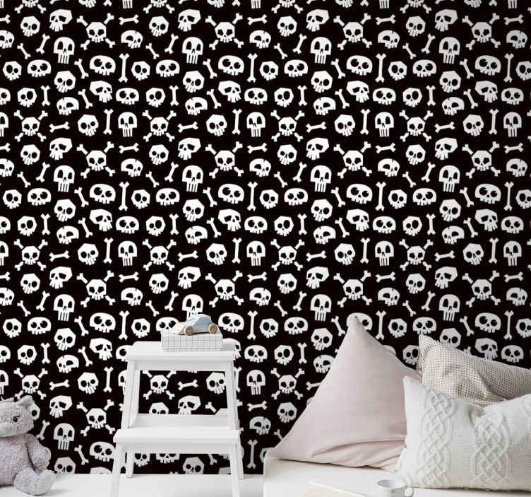 TenStickers. Halloween skelet met behang. Zwart en wit behang voor de kinderkamer. Een ontwerp gevuld met verschillende prints van witte skeletschedels en botten op een zwarte achtergrond.
