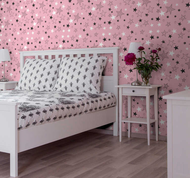 TenStickers. Pink Stars Bedroom Wallpaper. Fantastic stars vinyl wallpaper with white and black stars on a pink background that will look great in your daughter's room decor!