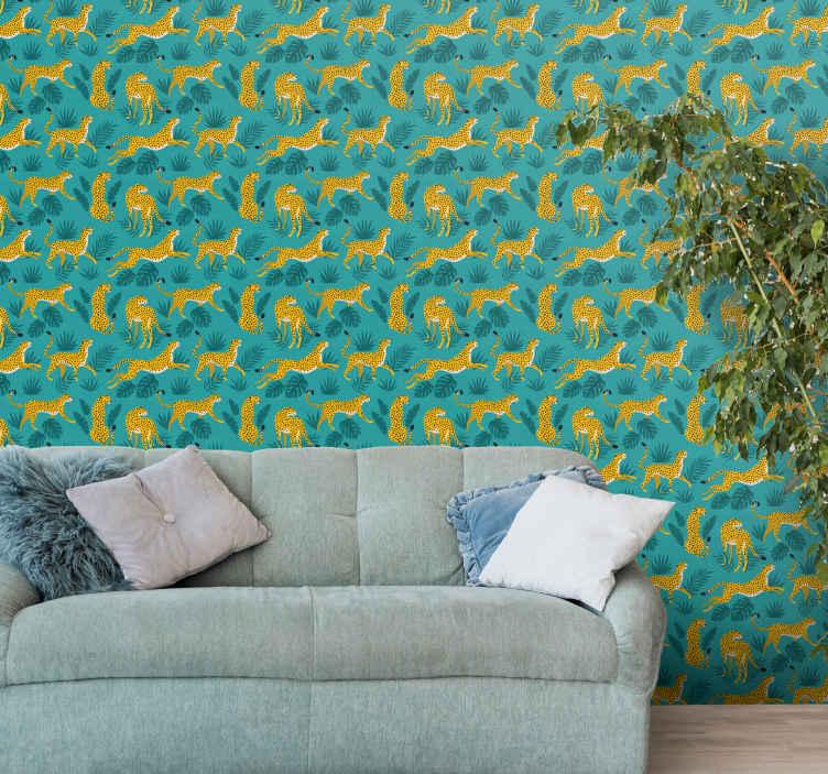 TenStickers. papel de parede animais Leopardo da selva. Papel de parede animal que apresenta um padrão de leopardos de desenhos animados em várias posições e folhas da selva. Materiais de alta qualidade.