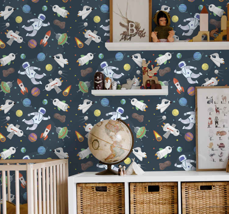TenStickers. Cartoon Space Kids Wallpaper. Space wallpaper which features a pattern of space themed objects including astronauts, rockets, satellites, planets and asteroids.