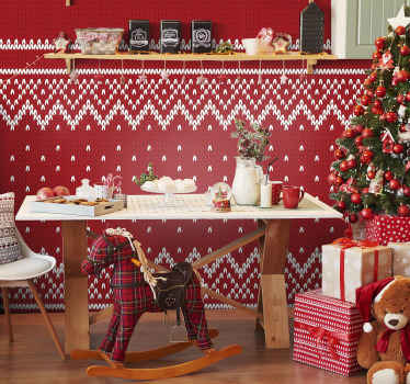 A typical patterned Christmas wallpaper design featured on a red background with ornamental patterns that form a Christmas tree.
