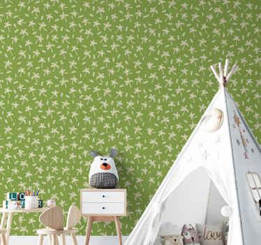 Eine palmen-tapete schmückt die wände des kinderzimmers. Eine weiß und grün gefärbte Tapete aus hochwertigem vinyl.