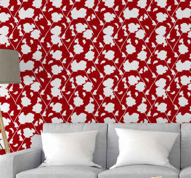 Brilliant red background wallpaper with white roses printed all over it . Beautiful to decorate a living room and for other common spaces.