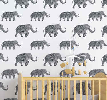 Ethnic elephants grey children wallpaper to decorate your little one's room. It host a white background with prints of grey elephants all over it.