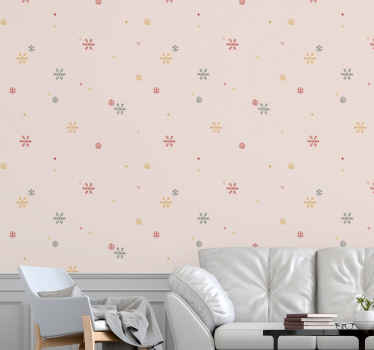 The delicate snow flakes in gentle colours of pastel blue, yellow and red on a light, almost white background on a living room wallpaper. Must buy!
