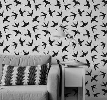 Papel de parede moderno com a ilustração de diversas silhuetas de pássaros na cor preta com fundo cinza que traz um toque elegante e clássico.